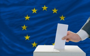 2419306-man-voting-on-elections-in-europe-in-front-of-flag